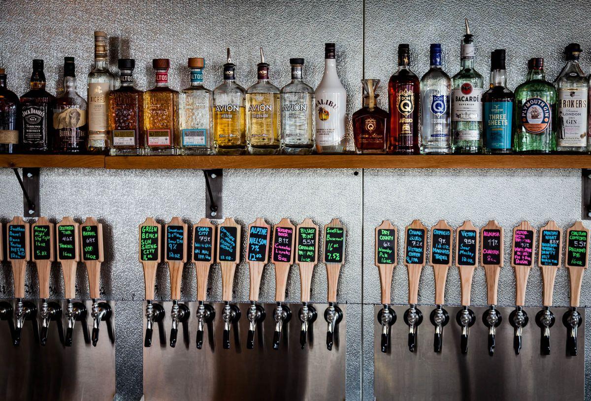 Beer taps and liquor bottles behind the bar at Barleygarden.