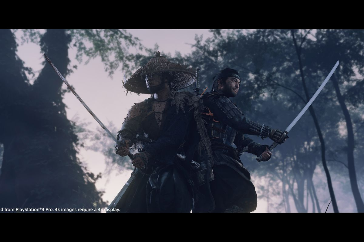A still from Ghost of Tsushima with two samurai standing back to back in a forest