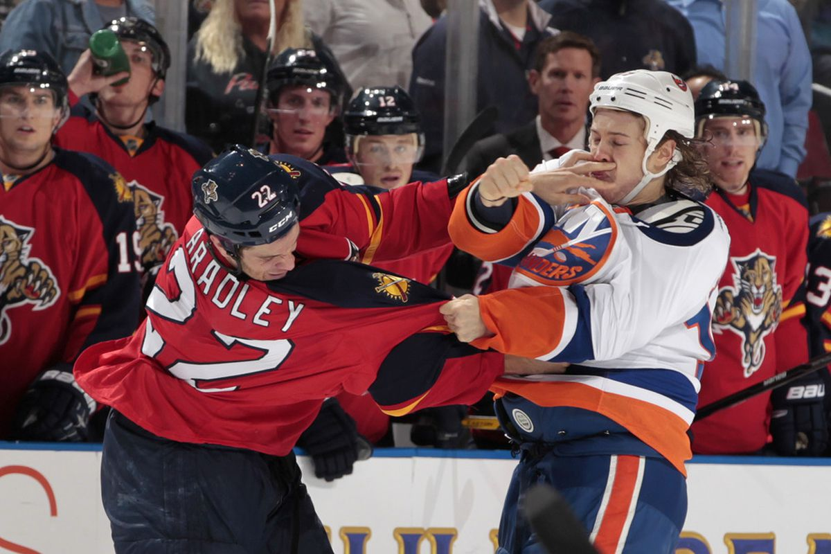 SUNRISE, FL - OCTOBER 22: Matt Bradley #22 of the Florida Panthers and Matt Martin #17 of the New York Islanders fight during the first period on October 22, 2011 at the BankAtlantic Center in Sunrise, Florida. (Photo by Joel Auerbach/Getty Images)