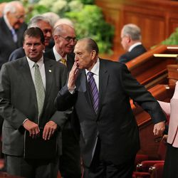 Thomas S. Monson, President of the Church of Jesus Christ of Latter-day Saints, with his daughter, Ann M. Dibb, sends a kiss to a friend at the end of the morning session of the 183rd Semiannual General Conference of the Church of Jesus Christ of Latter-day Saints Sunday, Oct. 6, 2013, in Salt Lake City.