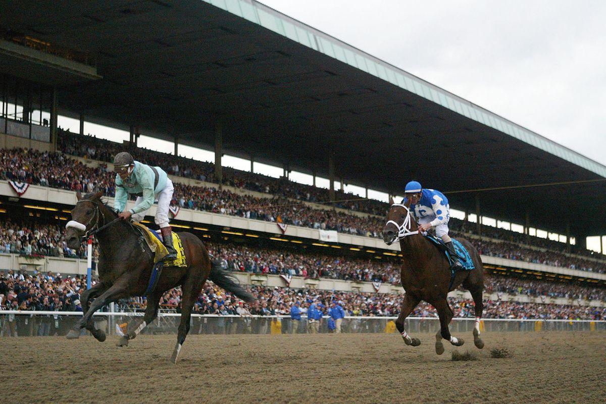 ELMONT, NEW YORK - JUNE 5: Birdstone (4), ridden by Edgar Prado wins 136th Belmont Stakes as Smarty Jones (9) ridden by Stewart Elliott comes in second on June 5, 2004 at in Elmont, New York. (Photo by Matthew Stockman/Getty Images)