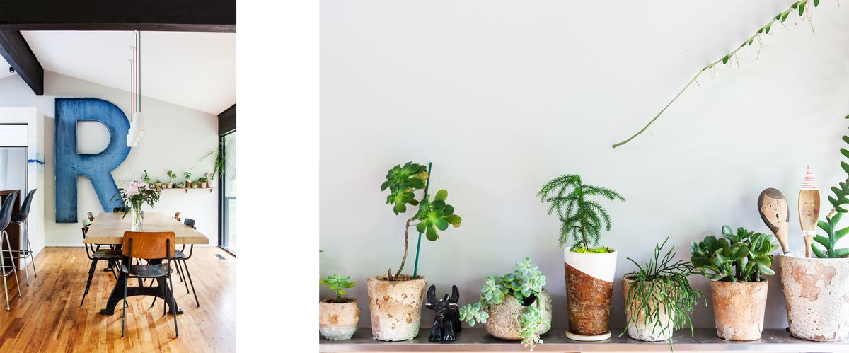 A large R decorates the wall in the dining room, a narrow shelf holds small potted plants.