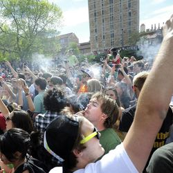 A crowd of marijuana supporters light up at 4:20 p.m. outside the Duane Physics building during the 4/20 rally on the University of Colorado campus in Boulder, Colo., on Friday, April 20, 2012. Many students at the University of Colorado and other campuses across the country have long observed 4/20. The counterculture observation is shared by marijuana users from San Francisco's Golden Gate Park to New York's Greenwich Village.