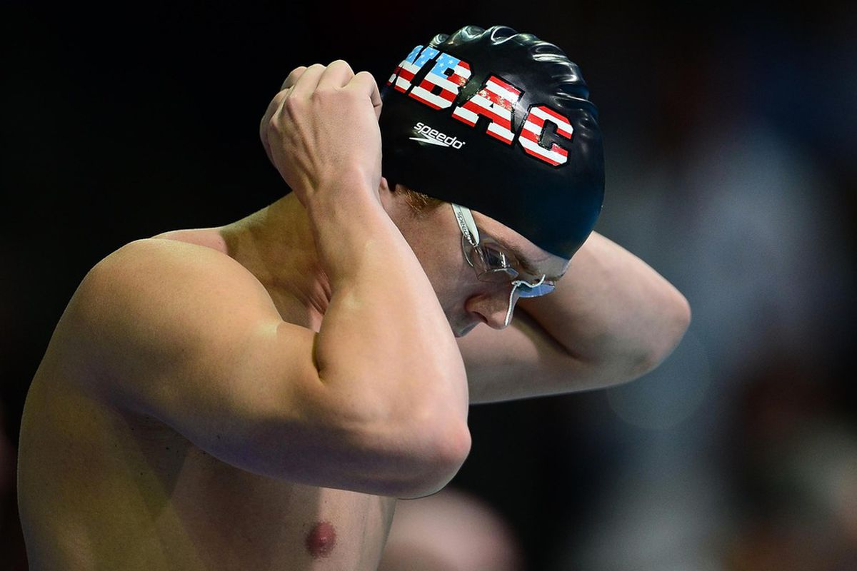 June 30, 2012; Omaha, NE, USA; Davis Tarwater adjusts his cap prior to competing in the mens 100m butterfly preliminary in the 2012 U.S. Olympic swimming team trials at the CenturyLink Center. Mandatory Credit: Andrew Weber-US PRESSWIRE