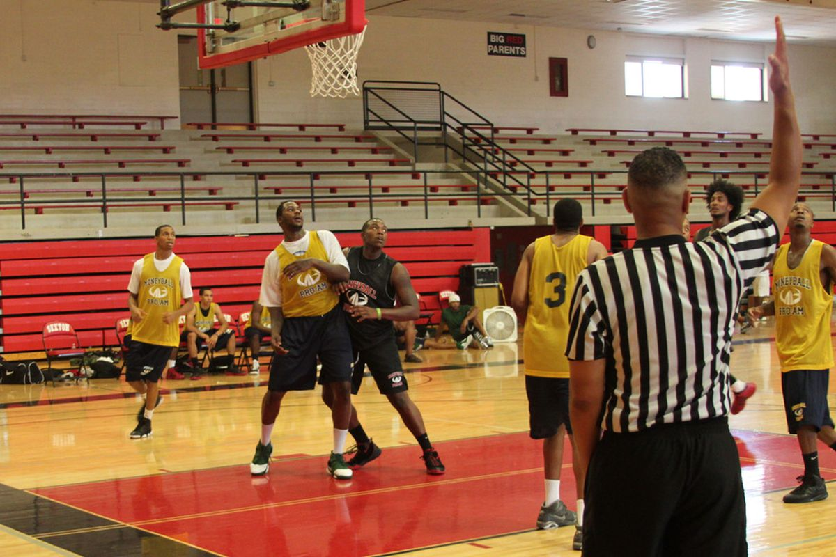 Derrick Nix tries to get position to rebound during the Moneyball Pro-Am at Lansing Sexton July 10. Photo: Patrick Hayes