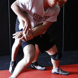 Doug Schulte, front, and Kevin Clem wrestle at Kingdom Klub in Woods Cross. Schulte lives with L-CHAD disease.
