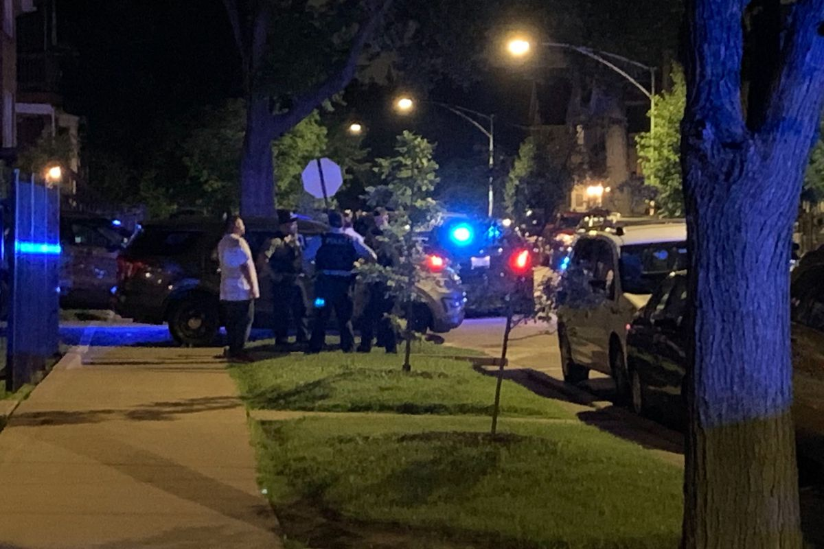 Chicago police investigate June 27, 2020, in the 3500 block of West Dickens Avenue where a 10-year-old girl was struck by a stray bullet that came through the window of a Logan Square apartment.