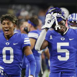 Brigham Young Cougars defensive back Jakob Robinson (0) and Brigham Young Cougars defensive back D'Angelo Mandell (5) celebrate a defensive stand during the Vegas Kickoff Classic in Las Vegas on Saturday, Sept. 4, 2021.