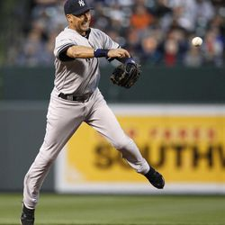 New York Yankees shortstop Derek Jeter throws to first base for an out after fielding a ground ball that was hit by Baltimore Orioles' J.J. Hardy in the first inning of a baseball game in Baltimore, Monday, April 9, 2012.