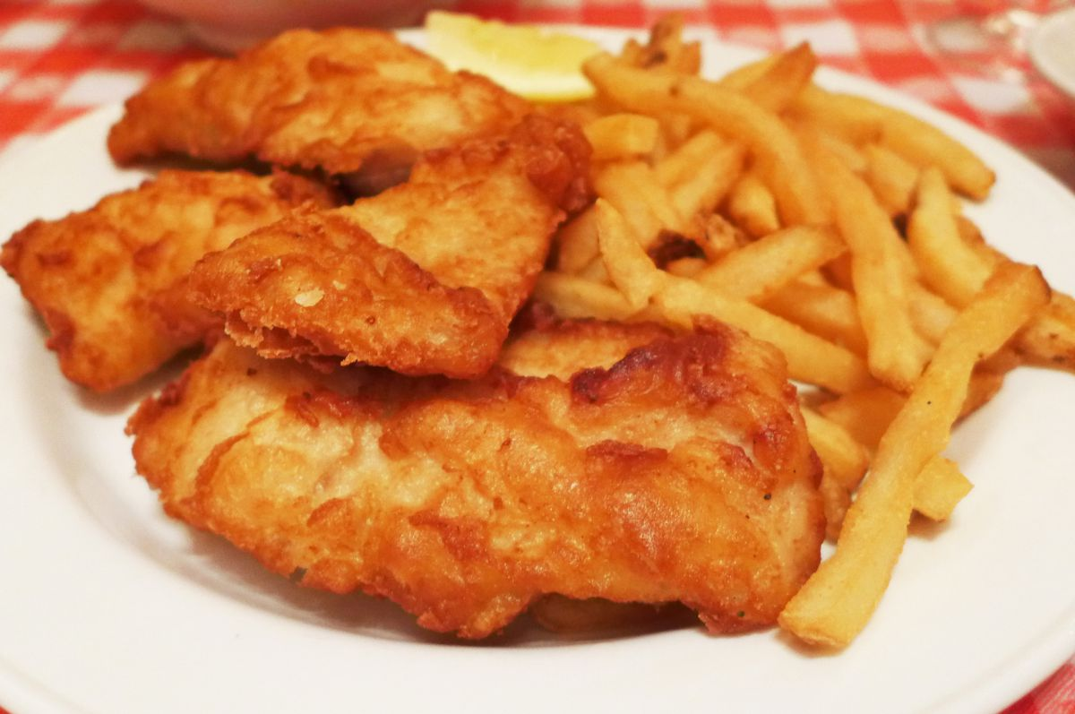 Fried fish filets heaped next to long thin french fries...