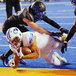 Brigham Young Cougars wide receiver Neil Pau'u (2) dives into the end zone for a touchdown as BYU and Boise State play a college football game at Albertsons Stadium in Boise on Friday, Nov. 6, 2020. BYU won 51-17.