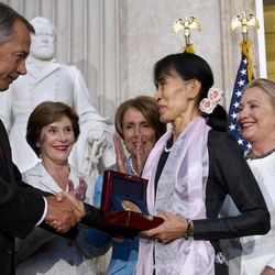 Myanmar democracy leader Aung San Suu Kyi, center, receives the Congressional Gold Medal from Speaker of the House John Boehner, at the U.S. Capitol in Washington, Wednesday, Sept. 19, 2012, as former first lady Laura Bush, back left, House Democratic Leader Nancy Pelosi, Secretary of State Hillary Rodham Clinton, and Senate Republican Leader Mitch McConnell, watch.