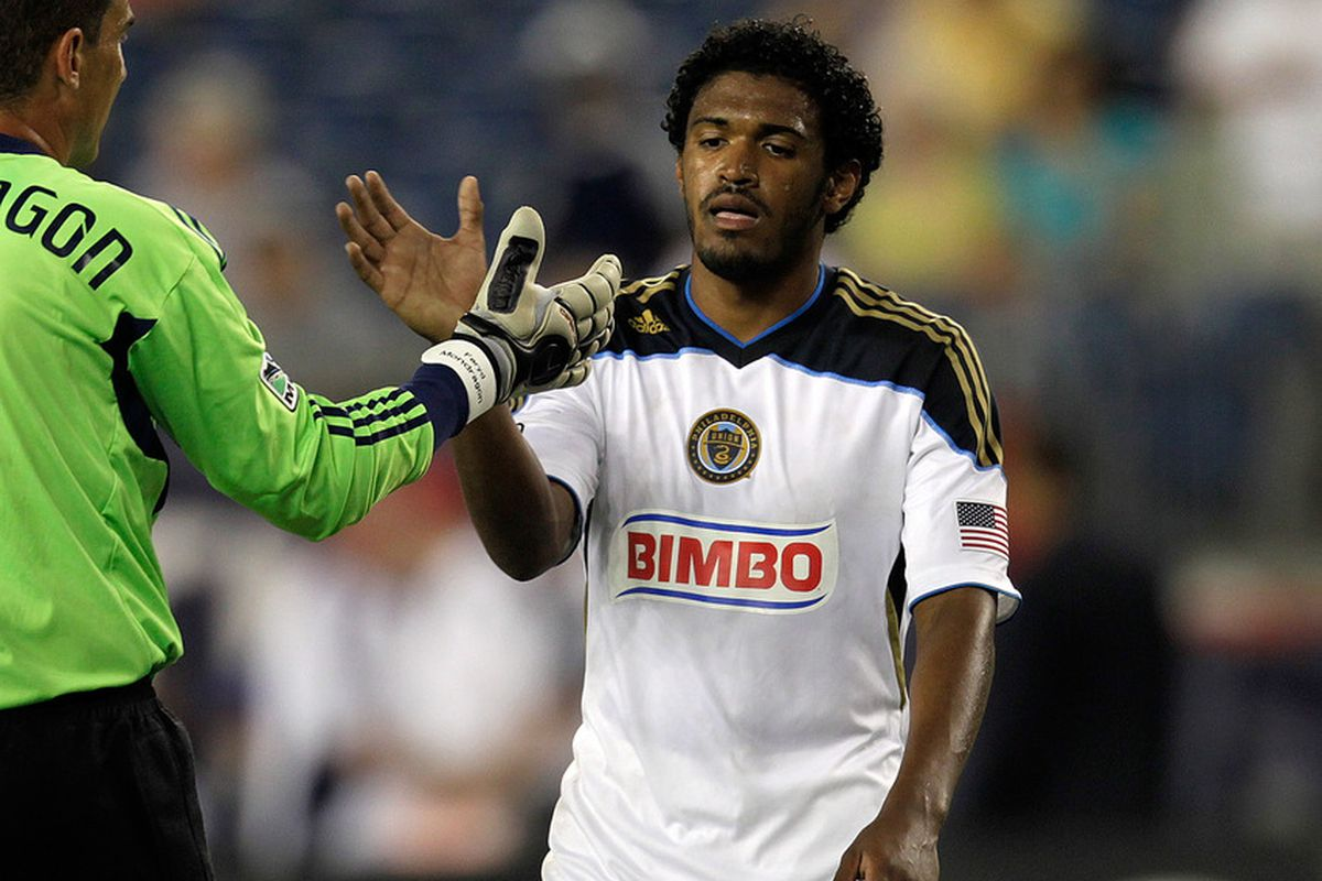 FOXBORO, MA - JULY 17:  Sheanon Williams #25 and Faryd Mondragon #1 of the Philadelphia Union celebrate their win over the New England Revolution at Gillette Stadium on July 17, 2011 in Foxboro, Massachusetts. (Photo by Jim Rogash/Getty Images)