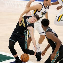 Utah Jazz forward Georges Niang (31) fouls Memphis Grizzlies guard Grayson Allen (3) as the Utah Jazz and the Memphis Grizzlies play in game one of their NBA playoff series at Vivint Arena in Salt Lake City on Sunday, May 23, 2021.
