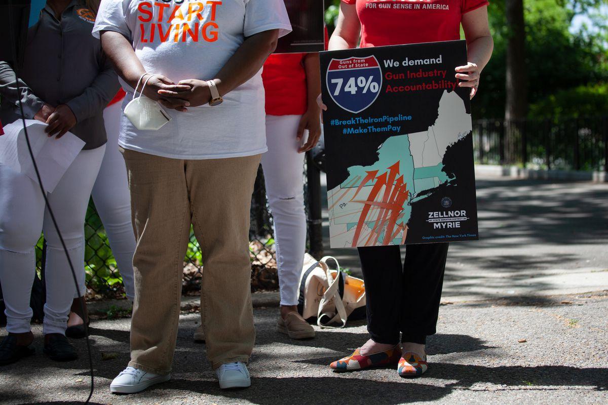 Gun control advocates rally in Brooklyn's Lincoln Terrace Park.