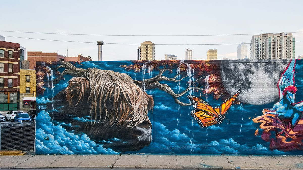 """Thomas Turner's side of the untitled mural uses his style of photo-realistic art to """"create drama"""" and show wind in the long hair of a highland bull."""