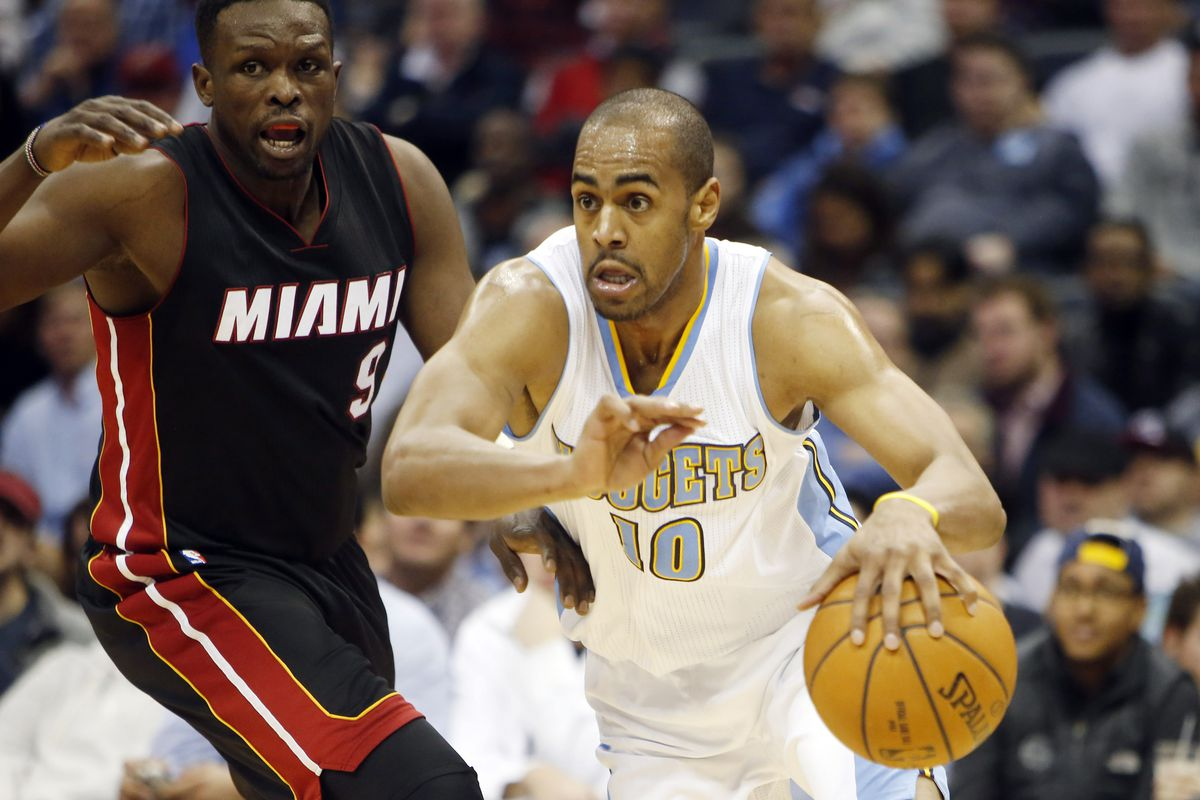 Arron Afflalo (R) and the Denver Nuggets used a balance and fast attack to beat the Miami Heat