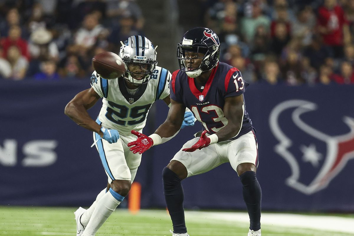 Houston Texans wide receiver Brandin Cooks (13) makes a reception as Carolina Panthers cornerback Rashaan Melvin (29) defends during the fourth quarter at NRG Stadium.