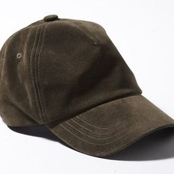 """<strong>L.L. Bean Signature</strong> Suede Baseball Cap in Tidal Marsh, <a href=""""http://www.llbean.com/llb/shop/78868?feat=774-GN1&page=suede-baseball-cap&attrValue_0=Tidal%20Marsh&productId=1314640"""">$49</a>"""