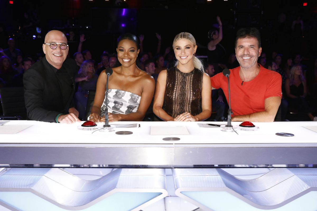 """Howie Mandel (from left), Gabrielle Union, Julianne Hough and Simon Cowell are photographed on the set of """"America's Got Talent,"""" in Los Angeles. Union and Hough will not be returning to the hit series next season."""