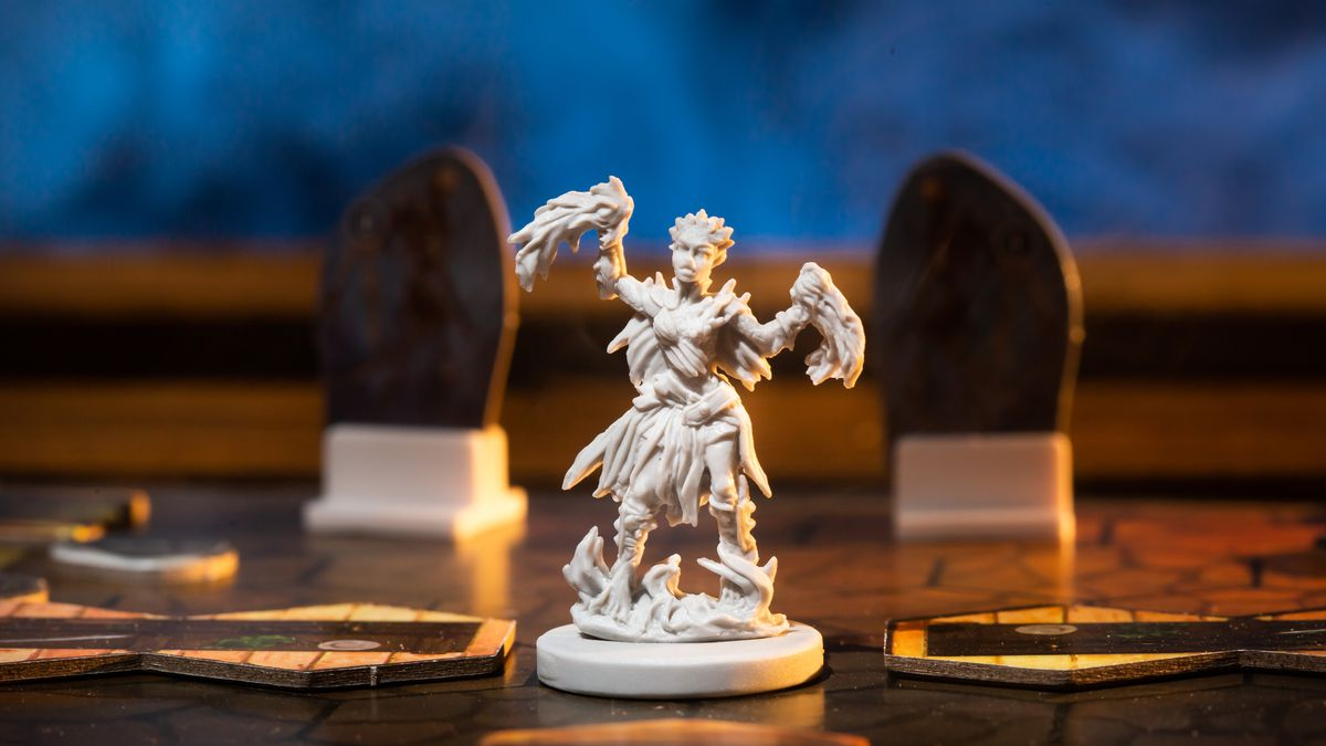 A spellcaster from Gloomhaven in a smokey photoshoot.