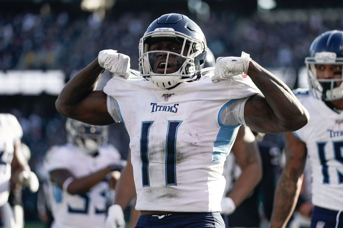 Tennessee Titans wide receiver A.J. Brown celebrates after scoring a touchdown against the Oakland Raiders during the second quarter at Oakland Coliseum