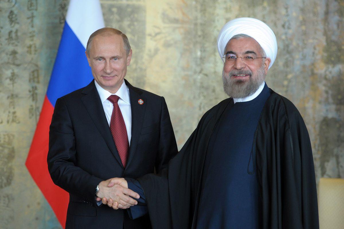 Russian President Vladimir Putin with Iranian President Hassan Rouhani in Shanghai in 2014.