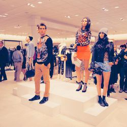 The live models in front of Topshop on the second floor.