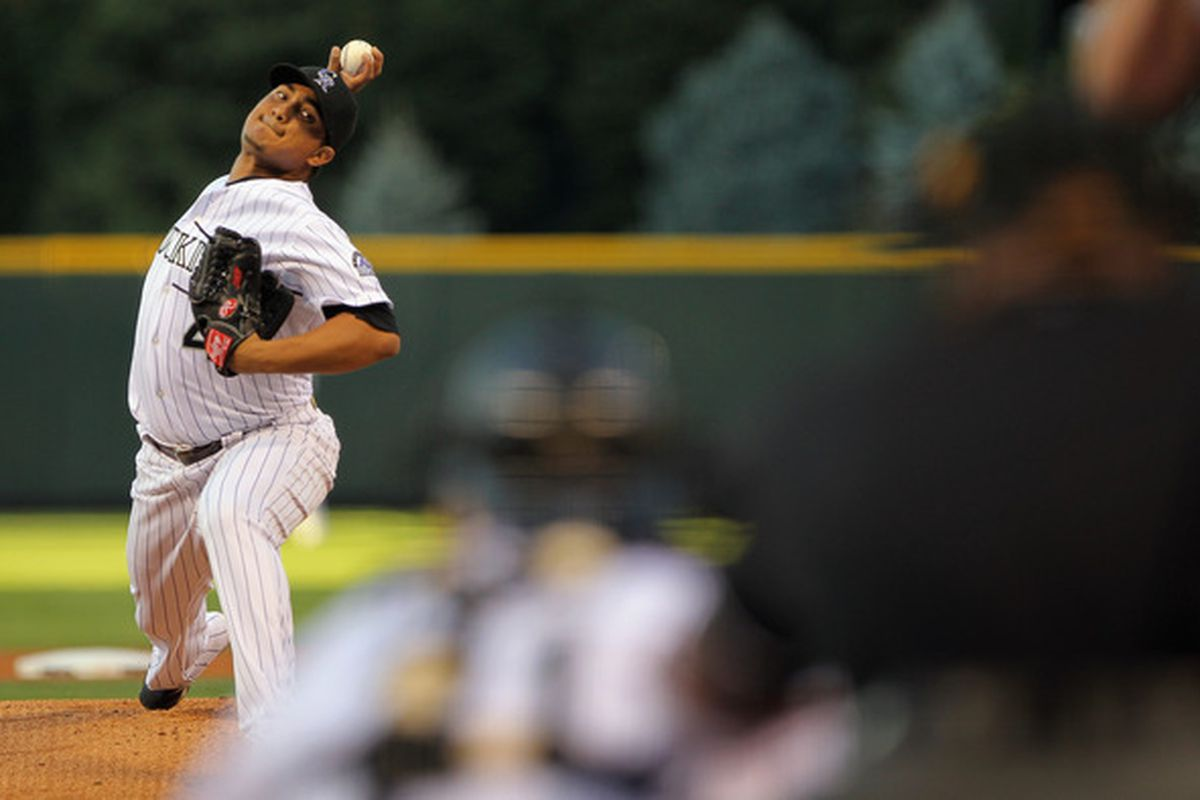 DENVER - SEPTEMBER 24:  Starting pitcher Jhoulys Chacin #45 of the Colorado Rockies delivers against the San Francisco Giants at Coors Field on September 24 2010 in Denver Colorado.  (Photo by Doug Pensinger/Getty Images)