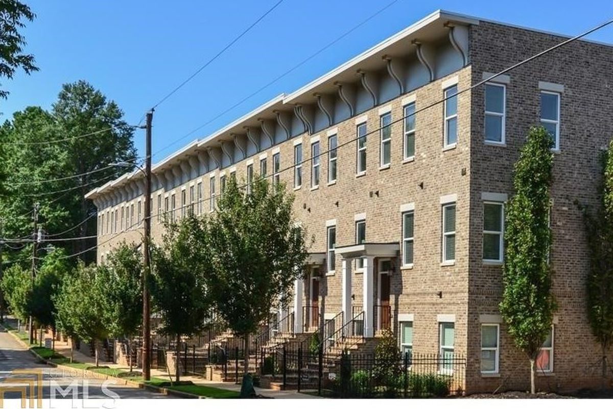A new townhouse development in Old Fourth Ward has more traditional, brick exteriors.