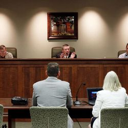 Garfield County Commissioners Dell LeFevre, Leland Pollock and David Tebbs conduct a meeting Monday, June 8, 2015, in Panguitch discussing county economic troubles and declining school enrollment since 1996.