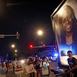 Protestors march through the streets |  Jim Young/Getty Images