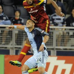 Real Salt Lake's Chris Schuler heads the ball over Sporting KC's Dom Dwyer during a game at Sporting Park in Kansas City, Kan., on Saturday, April 5, 2014.