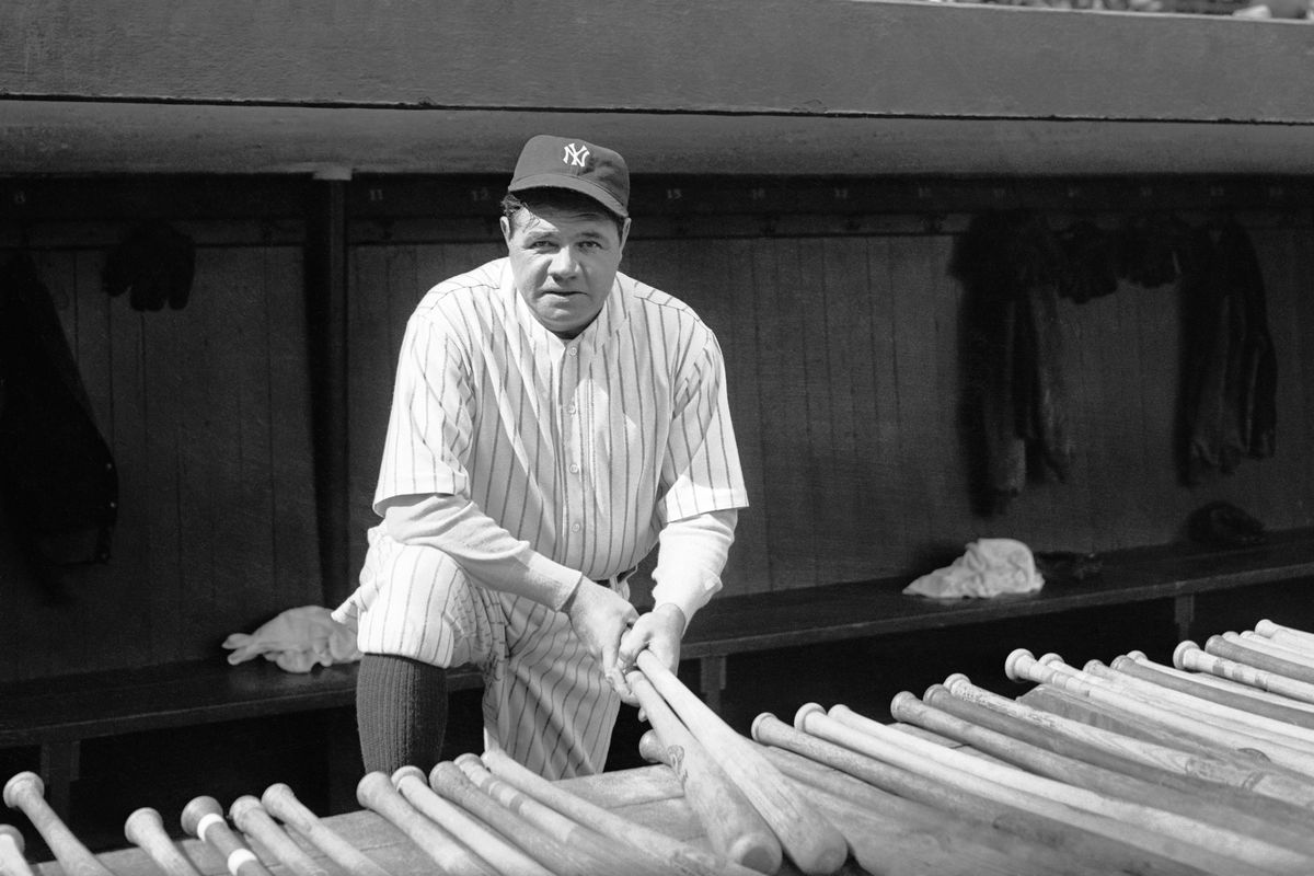 Babe Ruth Holding Baseball Bats