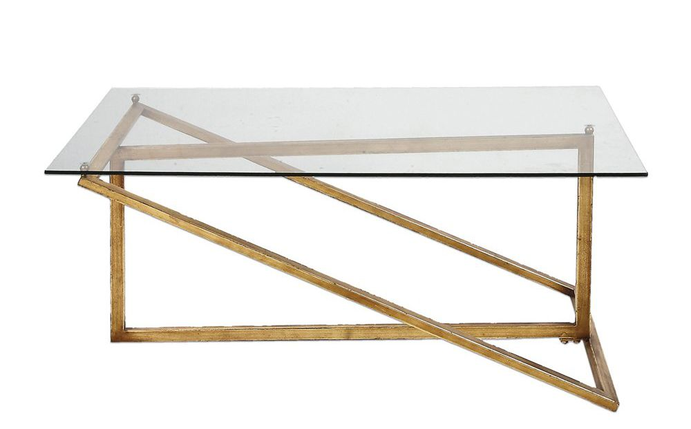 A coffee table with an angular gold base and glass top.