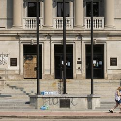 The front of the Kenosha County Courthouse was spray painted in downtown Kenosha during unrest overnight after police shot a Black man, Jacob Blake, in the the 2800 block of 40th Street, Monday morning, Aug. 24, 2020.