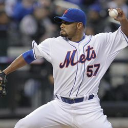 New York Mets pitcher Johan Santana throws during the first inning of a baseball game against the Miami Marlins on Tuesday, April 24, 2012, at Citi Field in New York.