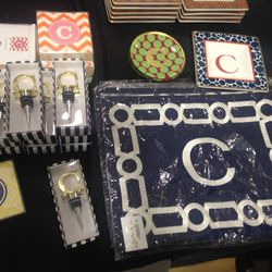 Monogrammed wine stoppers, $15; placemats, $3; stationary, $2