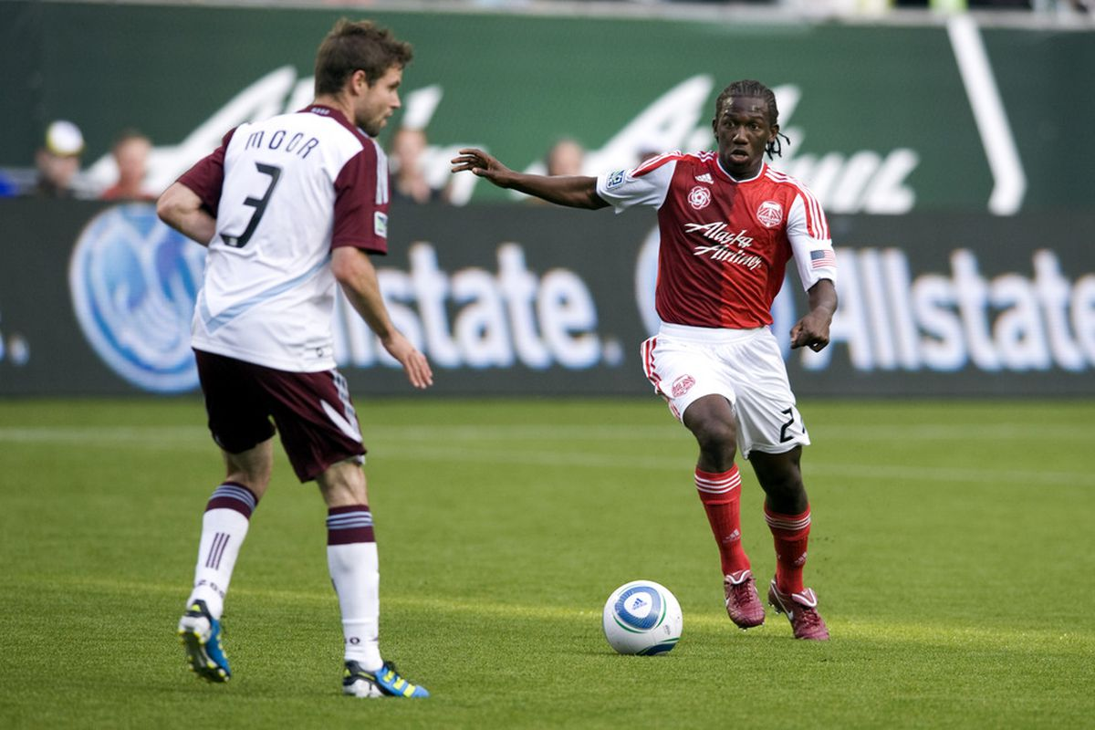 PORTLAND, OR - JUNE 11: Diego Chara #21 of the Portland Timbers drives on Drew Moor #3 of the Colorado Rapids during the first half of the game at Jeld-Wen Field on June 11, 2011 in Portland, Oregon. (Photo by Steve Dykes/Getty Images)