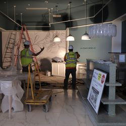 Hightech Signs employees work in the Hip & Humble shop space as construction of the new Salt Lake International Airport continues in Salt Lake City on Friday, May 22, 2020.