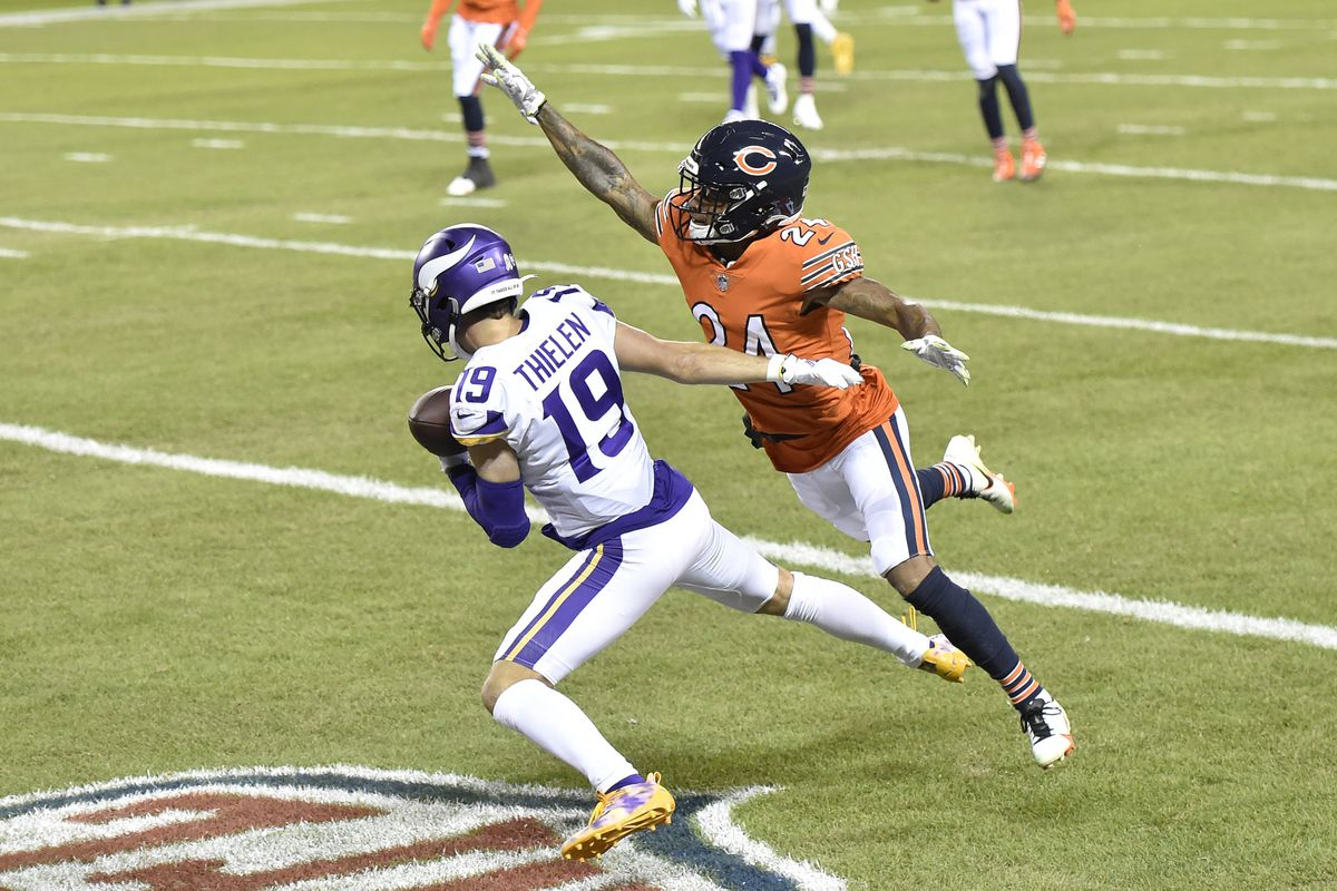 Minnesota Vikings wide receiver Adam Thielen  scores a touchdown in the first quarter against Chicago Bears cornerback Buster Skrine  at Soldier Field.