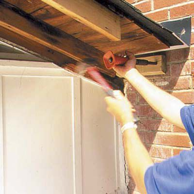 Man Attaches Cleat For New Overhang With Nailer