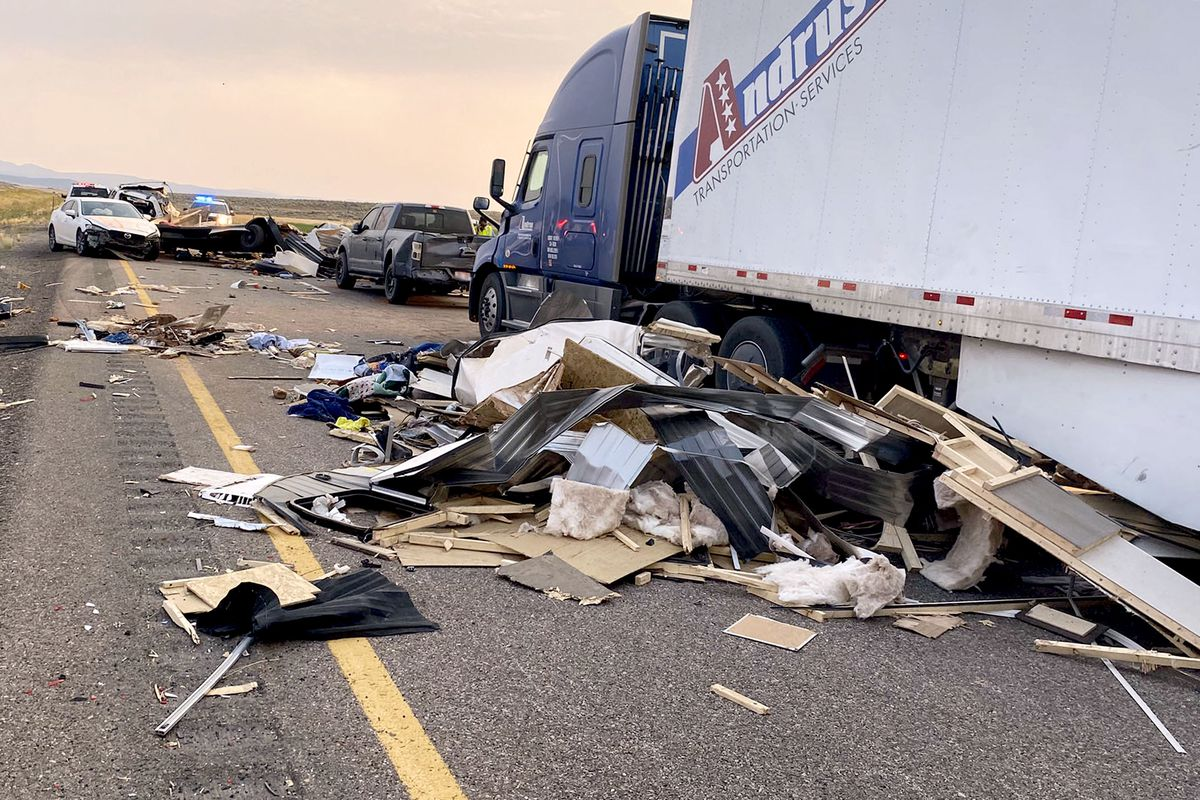 This photo provided by the Utah Highway Patrol shows the scene on Interstate 15 near Kanosh on Sunday, July 25, 2021, after a sand or dust storm led to multiple crashes involving 22 vehicles, according to authorities. The Utah Highway Patrol said eight people died, including some children, and at least 10 more were hospitalized following Sunday's incident.