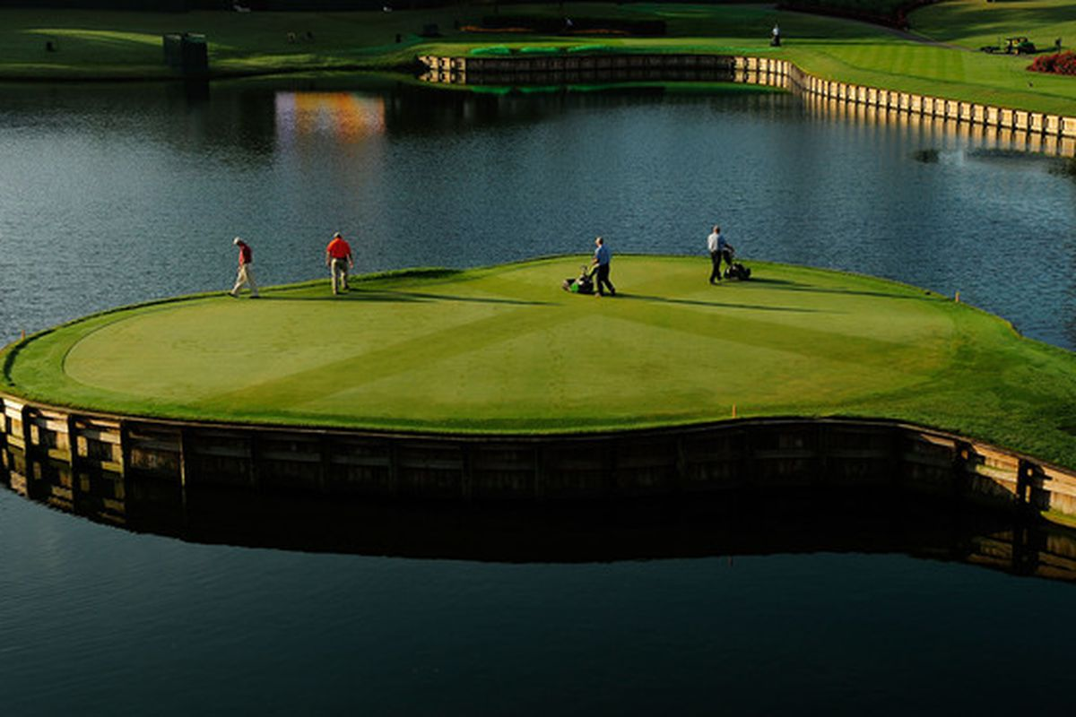 PONTE VEDRA BEACH, FL - MAY 03:  The grounds crew prepares the 17th hole prior to a practice round for THE PLAYERS at TPC Sawgrass on May 3, 2010 in Ponte Vedra Beach, Florida.  (Photo by Sam Greenwood/Getty Images)