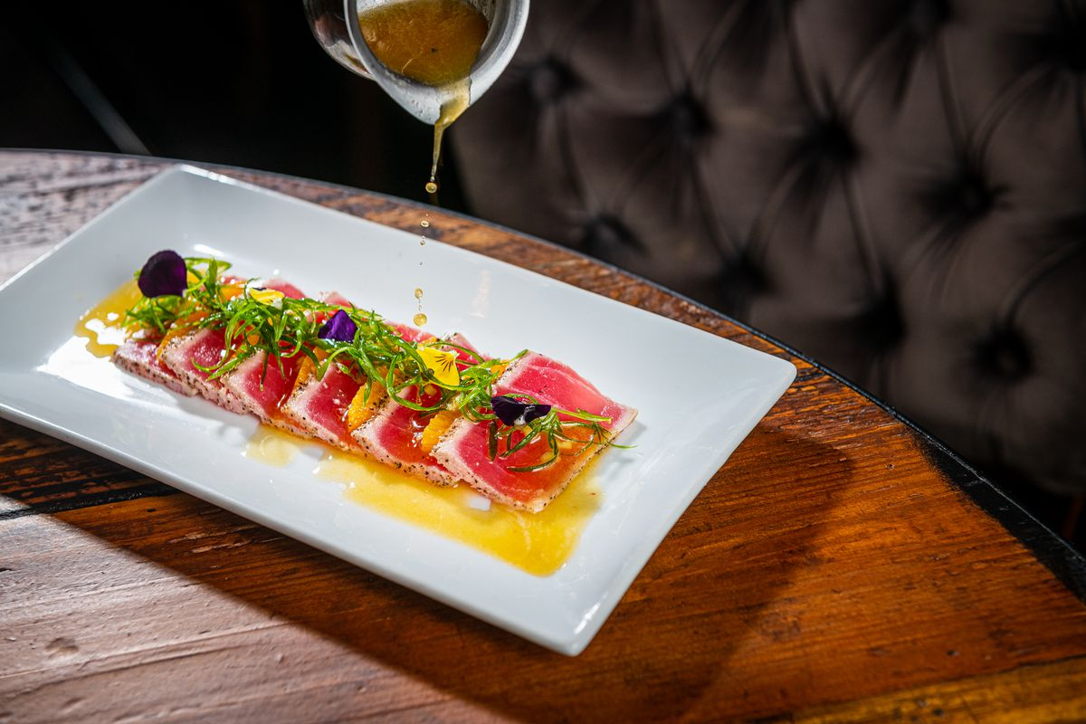 Japanese-style sashimi gets a cool kick from a passionfruit leche de tigre poured tableside.
