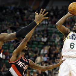 Utah Jazz shooting guard Lester Hudson (6) shoots over Portland Trail Blazers power forward Thomas Robinson (41) and Portland Trail Blazers shooting guard Will Barton (5) in the second half of a game at the Energy Solutions Arena on Wednesday, October 16, 2013.