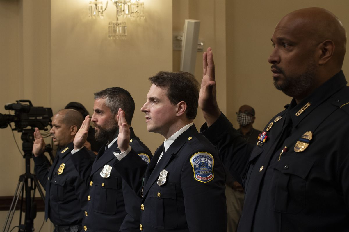Aquilino Gonell, sergeant of the U.S. Capitol Police, Michael Fanone, officer for the Metropolitan Police Department, Daniel Hodges, officer for the Metropolitan Police Department, and Harry Dunn, private first class of the U.S. Capitol Police, are sworn in during a hearing of the House select committee investigating the January 6 attack on the U.S. Capitol on July 27, 2021 at the Canon House Office Building in Washington, DC.