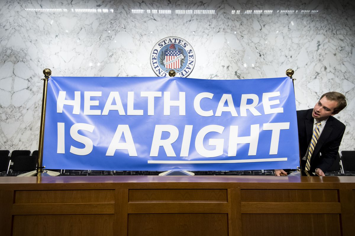 Staffers set up signs for Sen. Bernie Sanders' event to introduce the Medicare for All Act of 2017 on Wednesday, Sept. 13, 2017.