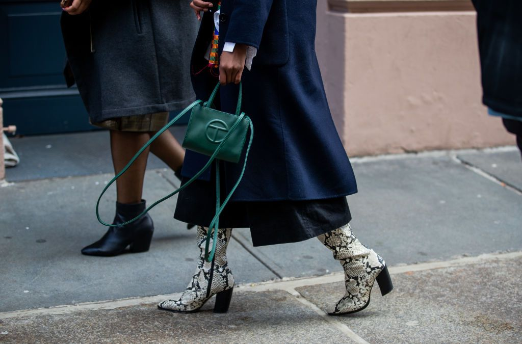 A fashionable person holds a Telfar bag.