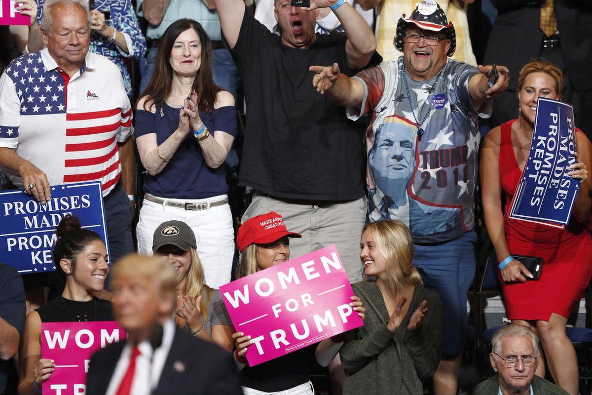 Audience members react as President Donald Trump speaks during a rally, Wednesday, June 21, 2017, in Cedar Rapids, Iowa.